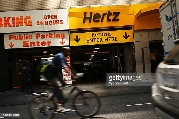 Hertz car rental agency stands in Manhattan on June 30 2016 in New York City In an effort to expand its presence in the ridehailing business Hertz...