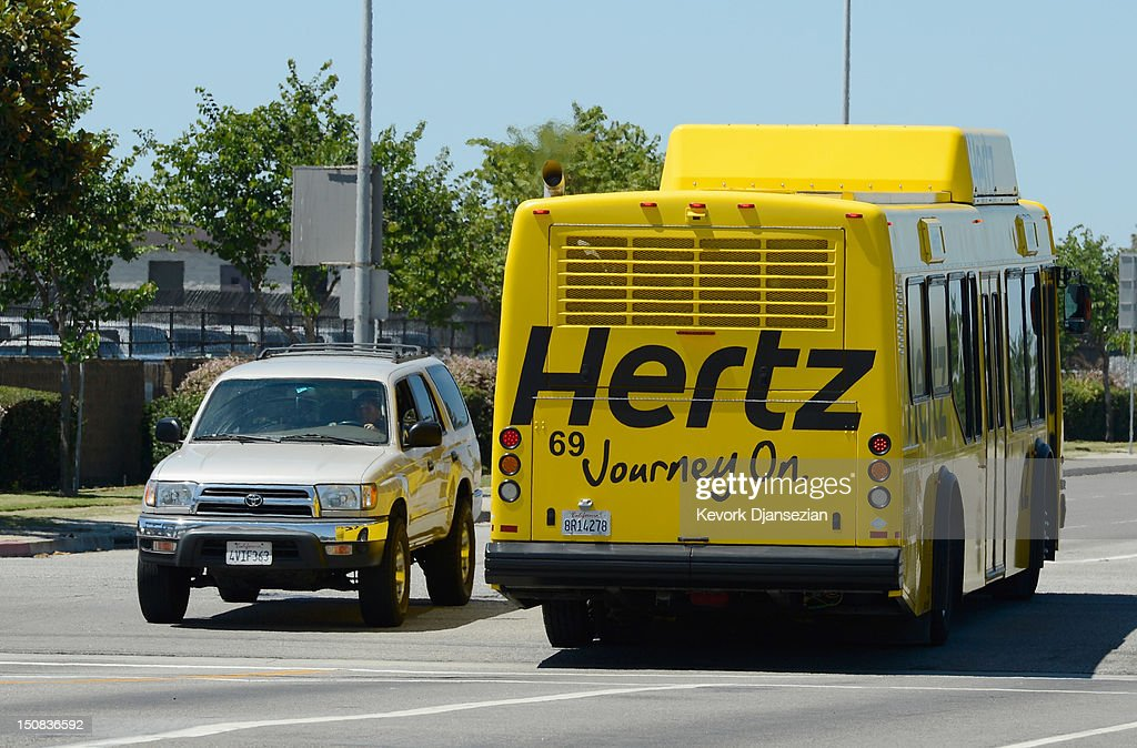 A Hertz Global Holdings car rental bus takes customers to Los Angeles International Airport August 27, 2012 in Los Angeles, California. Two major rental car companies agreed to merge as Hertz Global Holdings announced it is acquring Dollar Thrifty Automotive Group for $2.3 billion.