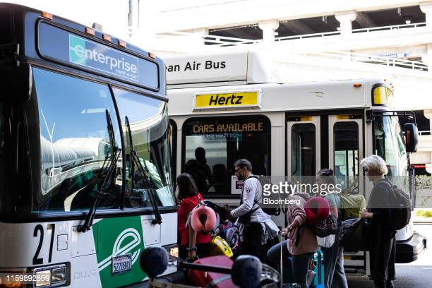 Hertz Global Holdings Inc. And a Enterprise Holdings Inc. Shuttle bus picks up passengers at Los Angeles International Airport in Los Angeles,...