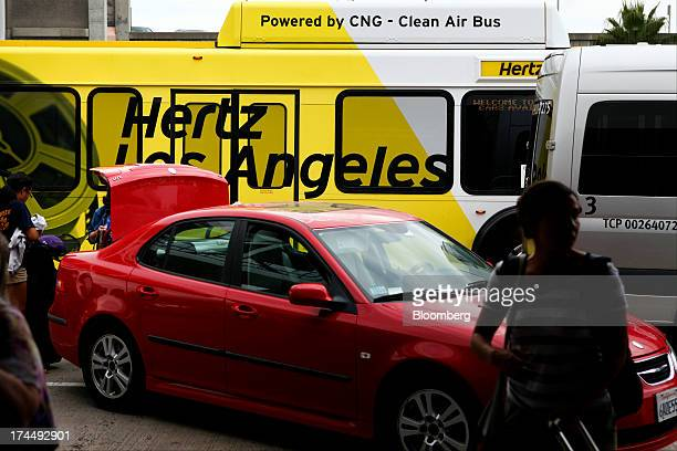 A Hertz Global Holdings Inc shuttle bus drops off passengers at Los Angeles International Airport in Los Angeles California US on Friday July 26 2013...