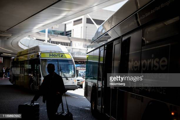 Hertz Global Holdings Inc. Shuttle bus sits in traffic before picking up customers at Los Angeles International Airport in Los Angeles, California,...