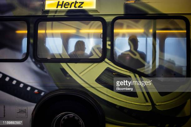 Hertz Global Holdings Inc. Shuttle bus transports passengers to the rental location at Los Angeles International Airport in Los Angeles, California,...