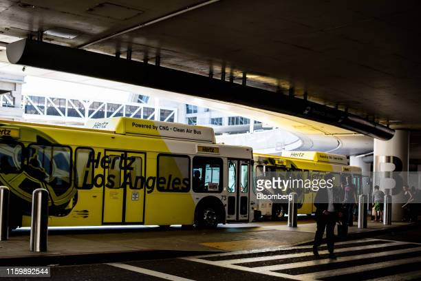 Hertz Global Holdings Inc. Shuttle buses pick up customers at Los Angeles International Airport in Los Angeles, California, U.S. On Friday, Aug. 2,...