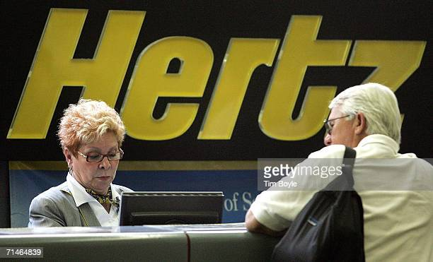 Hertz worker assists a customer at its rentalcar pickup area July 17 2006 at O'Hare International Airport in Chicago Illinois Hertz has filed for a...