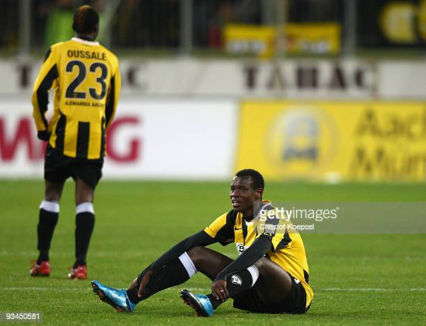Hervé Oussalé and Seyi Olajengbesi of Aachen look dejected after losing 02 the second Bundesliga match between Alemannia Aachen and Rot Weiss Ahlen...