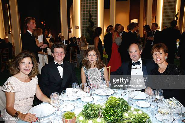 Herve Aaron and his wife Marina attend the 27th 'Biennale des Antiquaires' Pre Opening at Le Grand Palais on September 9 2014 in Paris France