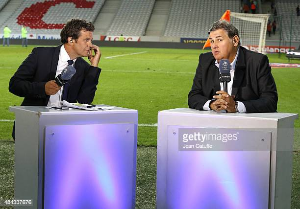 Herve Mathoux and Pierre Menes comment for Canal Plus the French Ligue 1 match between Lille OSC and Paris SaintGermain at Grand Stade Pierre Mauroy...