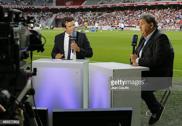 Herve Mathoux and Pierre Menes of Canal Plus comment the French Ligue 1 match between Lille OSC and Paris SaintGermain at Grand Stade Pierre Mauroy...