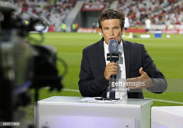 Herve Mathoux of Canal Plus comments the French Ligue 1 match between Lille OSC and Paris SaintGermain at Grand Stade Pierre Mauroy on August 7 2015...