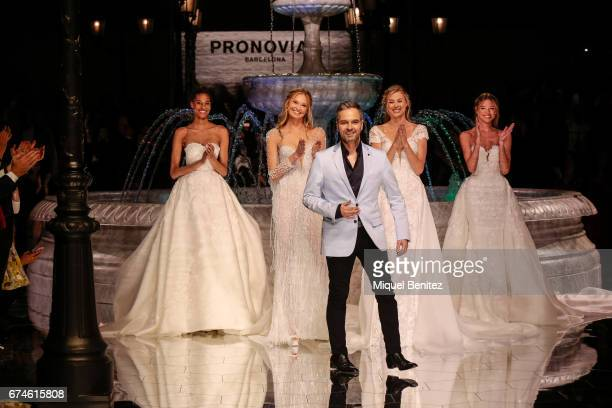 Herve Monreau and models walk the runway of the Pronovias Show during Barcelona Bridal Fashion Week 2017 held at the Museu Nacional d'Art de...