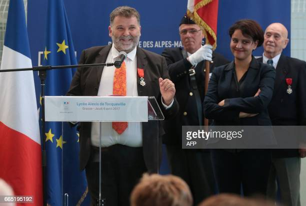 Herve Pizzinat head teacher of the Alexis de Tocqueville high school speaks next to French Education Minister Najat VallaudBelkacem after being...
