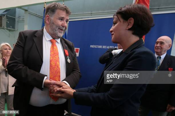 Herve Pizzinat head teacher of the Alexis de Tocqueville high school speaks to French Education Minister Najat VallaudBelkacem after being awarded...
