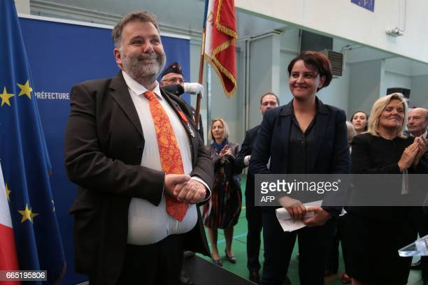 Herve Pizzinat head teacher of the Alexis de Tocqueville high school smiles next to French Education Minister Najat VallaudBelkacem after being...