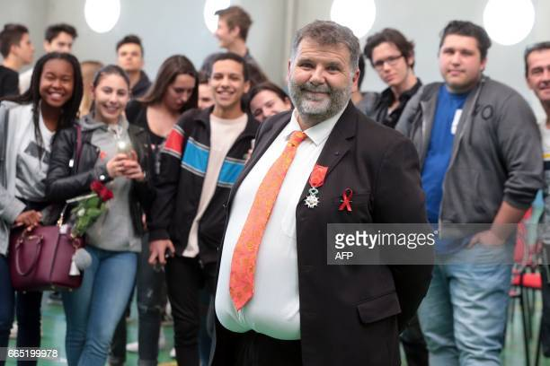 Herve Pizzinat head teacher of the Alexis de Tocqueville high school poses after being awarded the Legion d'Honneur in Grasse on April 6 2017 Herve...