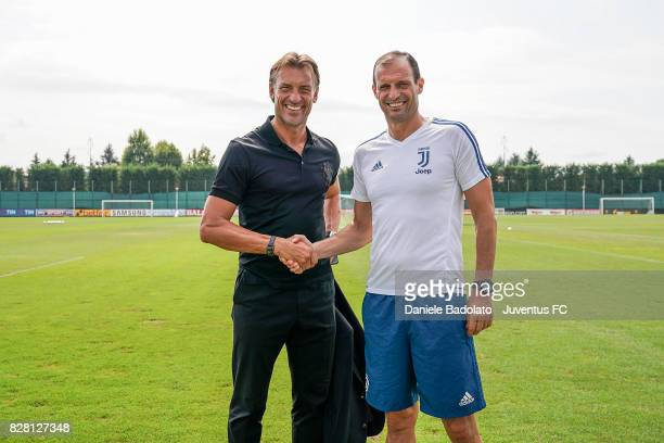 Herve Renard and Massimiliano Allegri of Juventus during a training session on August 9 2017 in Vinovo Italy