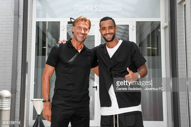 Herve Renard and Medhi Benatia of Juventus during a training session on August 9 2017 in Vinovo Italy