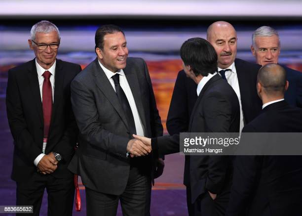 Herve Renard Manager of Morocco shake hands with Nabil Maaloul Manager of Tunisia during the Final Draw for the 2018 FIFA World Cup Russia at the...