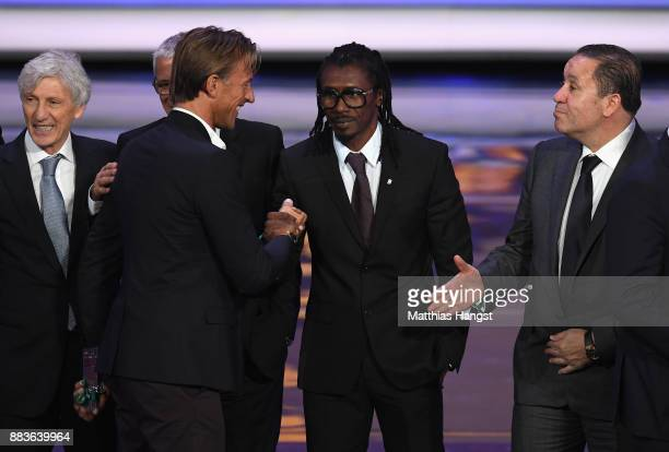 Herve Renard Manager of Morocco shakes hands with Aliou Cisse Manager of Senegal after the Final Draw for the 2018 FIFA World Cup Russia at the State...