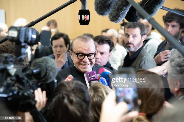 Herve Temime lawyer for French businessman Bernard Tapie speaks to television crews and journalists at the Porte de Clichy courthouse in Paris France...