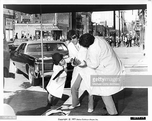 Herve Villechaize and Irving Selbst help injured Jerry Orbach to the truck in a scene from the film 'The Gang That Couldn't Shoot Straight' 1971