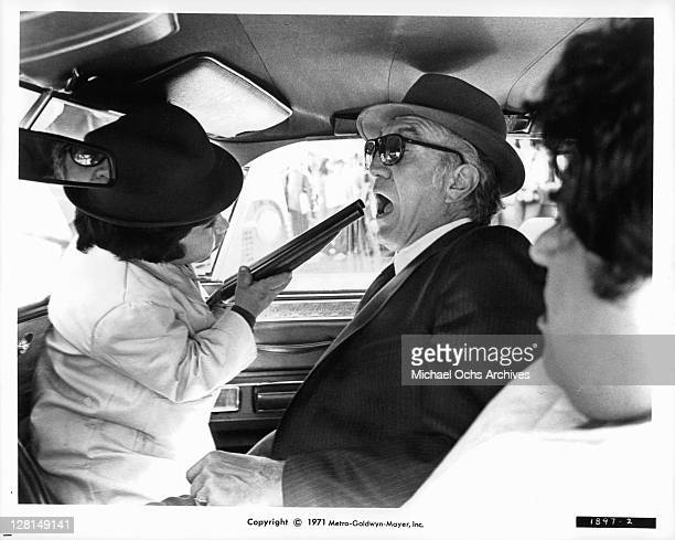 Herve Villechaize has a gun pointed at Frank Campanella in a scene from the film 'The Gang That Couldn't Shoot Straight' 1971
