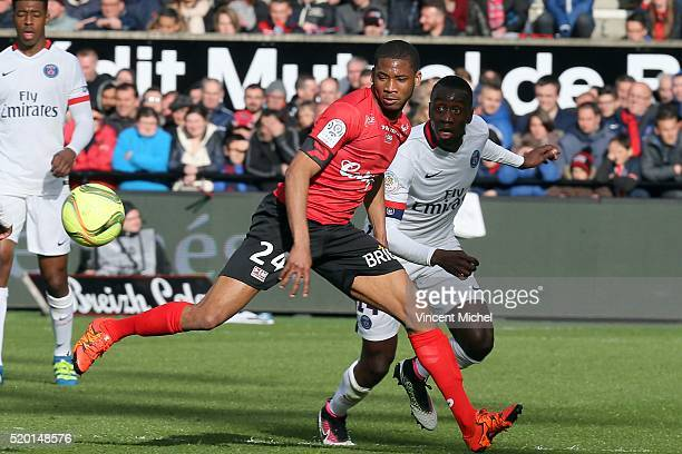 Hervin Ongenda of PSG and Marcus Coco of Guingamp during the French League 1 match between EA Guingamp and Paris SaintGermain on April 9 2016 in...