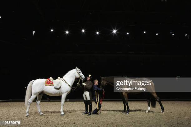 Herwig Radnetter of The Spanish Riding School of Vienna and his horse Pluto Sabata pose alongside Paralympic dressage champion Lee Pearson and his...