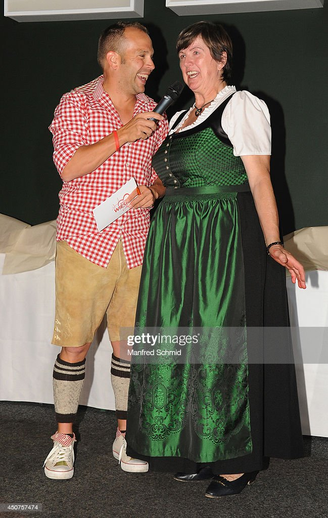 Herzerl Mitzi (R) wearing traditional Austrian outfit Dirndl attends the beauty competition 'Miss Wiener Wiesn-Fest 2014' at Platzhirsch on on June 12, 2014 in Vienna, Austria.