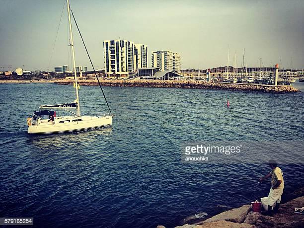 Herzlia marina with fisherman and boat, Israel