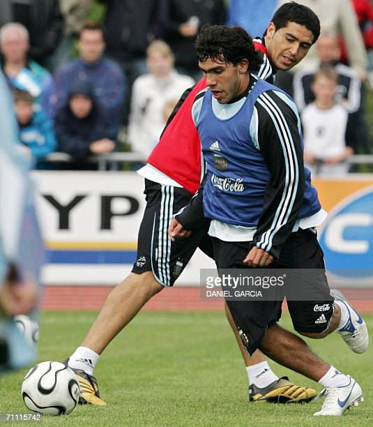 Argentine player Carlos Tevez passes teammate Juan Roman Riquelme at AdiDasslerSportplatz training camp in Herzogenaurach 03 June 2006 Argentina will...