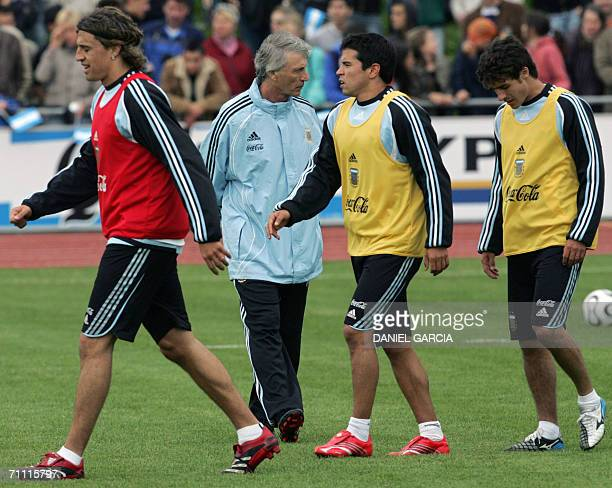 Argentine players Hernan Crespo Javier Saviola and Pablo Aimar walk before Argentina's head coach Jose Pekerman after a training at...