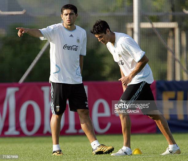 Argentinean midfielder Juan Roman Riquelme gestures as forward Julio Ricardo Cruz starts running at AdiDasslerSportplatz training camp in...