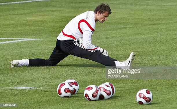 Germany's national football team's goalkeeper Jens Lehmann stretches during a training session 31 May 2007 in Herzogenaurach southern Germany prior...