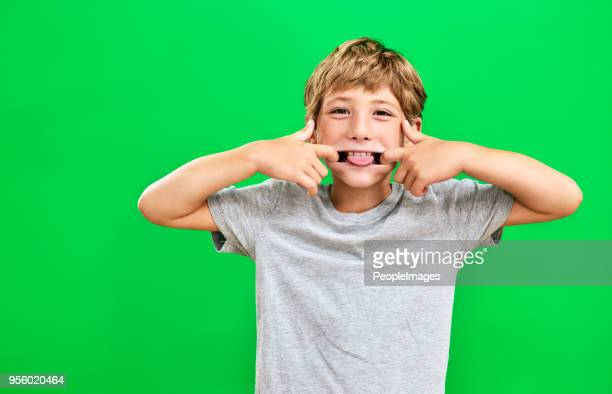 he's a cheeky little one - protruding stock pictures, royalty-free photos & images