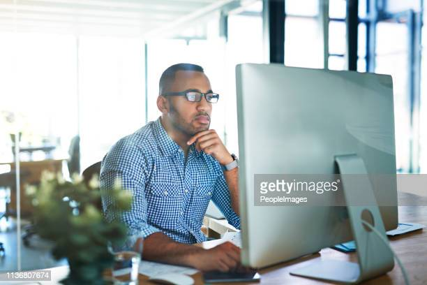 he's a diligent worker - using computer stock pictures, royalty-free photos & images