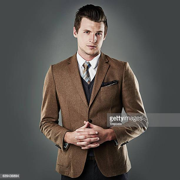 he's a real professional - brown suit stock photos and pictures