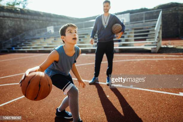 he's ahead of the game - basketball sport stock pictures, royalty-free photos & images