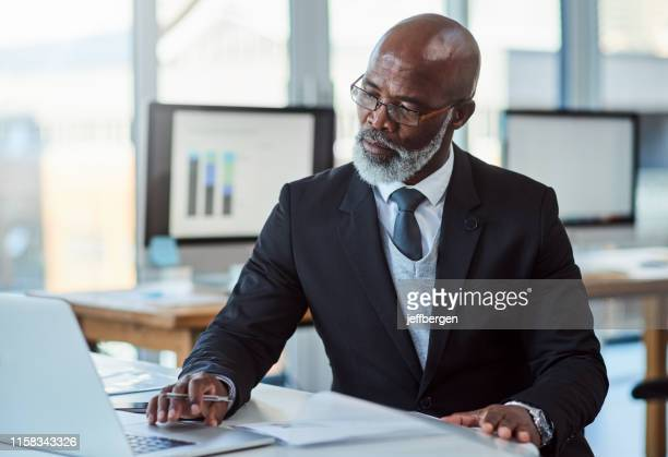 he's always a busy man - black stock pictures, royalty-free photos & images