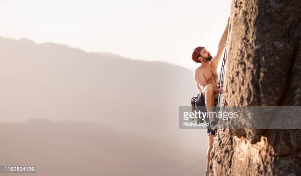 he's determined to reach the top - nicky pende foto e immagini stock