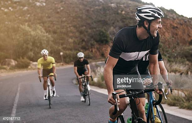 he's enjoying the ride - cycling stock pictures, royalty-free photos & images