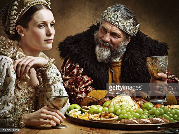 he's feasting and his goblet is full...again! - renaissance stock pictures, royalty-free photos & images