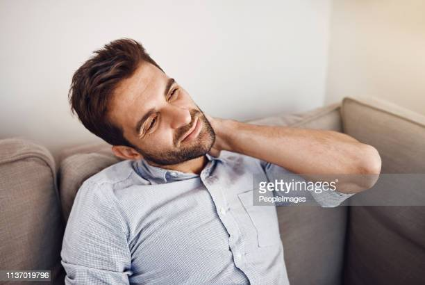 he's feeling a bit of tension on his neck - uncomfortable stock pictures, royalty-free photos & images