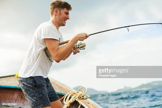 he's got a bite - deep sea fishing stock photos and pictures