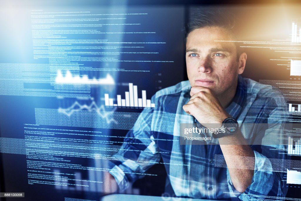 He's got a lot of information to shift through : Stock Photo