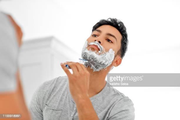 he's got razor sharp flexes - shaving stock pictures, royalty-free photos & images