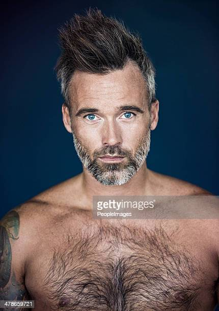 he's got rugged confidence - hairy chest stock photos and pictures