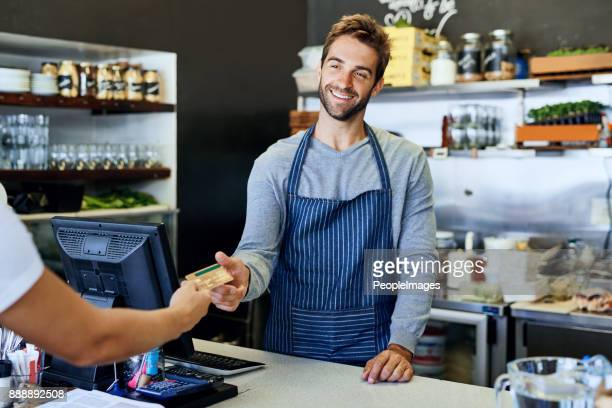 he's got smiles for every single customer - convenient store stock photos and pictures