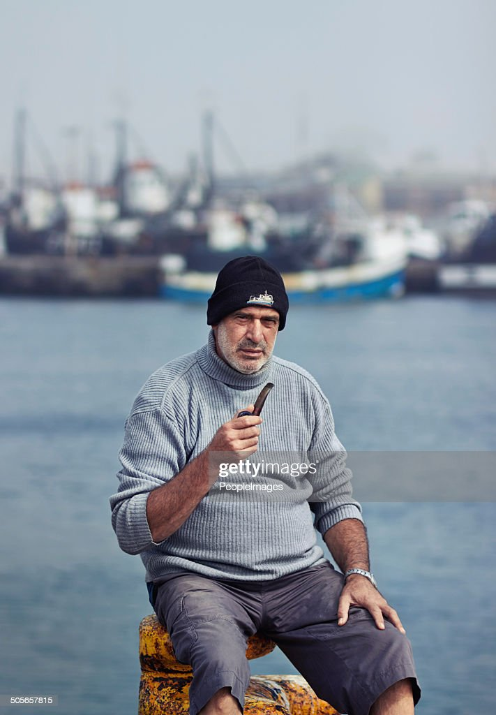 He's got some fishing stories to tell you! : Stock Photo