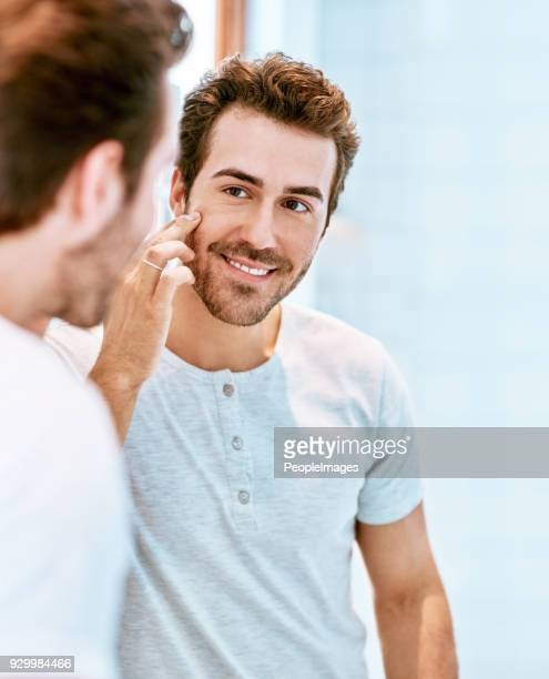 he's loving the great results his skin regime is giving - caucasian appearance stock pictures, royalty-free photos & images