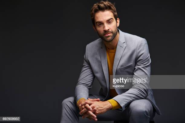 he's really pulling off that suit - men fashion stock pictures, royalty-free photos & images